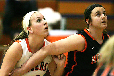 H. Rick Bamman - hbamman@shawmedia.com Crystal Lake Central's Shannon Ellman and McHenry's McKayla Snedeker vie for position for a rebound during the Class 4A Cary-Grove Regional game Monday, Feb. 17, 2014.Central beat McHenry 39-35.