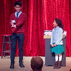 Magician Arman Sangalang 16, a Sophmore at St. Charles East High School performs a magic trick with the assistance of a member of the audience Daniella King 7, of St. Charles at Steel Beam Theatre in St. Charles, IL on Sunday, February 16, 2014 (Sean King for Shaw Media)