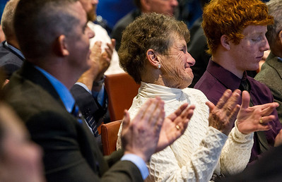 Kyle Grillot - kgrillot@shawmedia.com   Cary-Grove senior Matt Hughes' grandmother Karen Devine applauds her grandson after his speech during the National Football Foundation & College Football Hall of Fame Chicago Metro Awards ceremony Monday in Lake Forest. Jon and Karen Devine have been season ticket holders for years and they were able to attend the awards ceremony with their grandson. Hughes was one of three students awarded the Bears Community Champion Award for his efforts in community service outside of the football program at Cary-Grove.