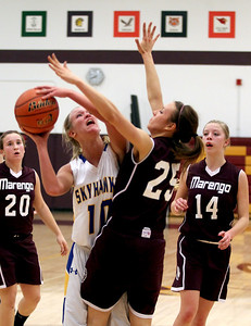 Sarah Nader - snader@shawmedia.com Johnsburgs' Trace Chase (left) shoots over Marengo's Nicole Johnston during the first quarter at the IHSA Class 3A Regional game in Richmond Tuesday, February 18, 2014.