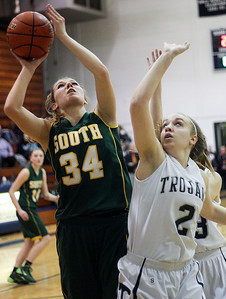 Sarah Nader- snader@shawmedia.com Crystal Lake South's Sara Mickow (left) is guarded by Cary-Grove's Katie Barker while she shoots during the first quarter of Wednesday's Class 4A Cary-Grove Regional  February 19, 2014. Cary-Grove defeated Crystal Lake South, 57-45.