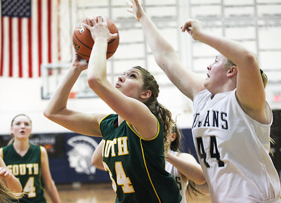 Sarah Nader- snader@shawmedia.com Crystal Lake South's Sara Mickow (left) is guarded by Cary-Grove's Brianne Prank while she shoots during the second quarter of Wednesday's Class 4A Cary-Grove Regional February 19, 2014. Cary-Grove defeated Crystal Lake South, 57-45.