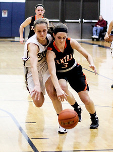 Sarah Nader- snader@shawmedia.com Prairie Ridge's Sarah LeBeau and Crystal Lake Central's Evelyn Youel run after a lose ball during the second quarter of the Class 4A Cary-Grove Regional on Wednesday, February 19, 2014. Prairie Ridge defeated Crystal Lake Central, 34-32.