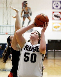 Sarah Nader- snader@shawmedia.com Prairie Ridge's Maddie Drain shoots during the fourth quarter of the Class 4A Cary-Grove Regional against Crystal Lake Central on Wednesday, February 19, 2014. Prairie Ridge defeated Crystal Lake Central, 34-32.
