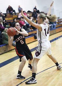 Sarah Nader- snader@shawmedia.com Crystal Lake Central's Maddie Helm (left) is guarded by Prairie Ridge's Sarah Kilhoffer while she makes a pass during the second quarter of the Class 4A Cary-Grove Regional on Wednesday, February 19, 2014. Prairie Ridge defeated Crystal Lake Central, 34-32.