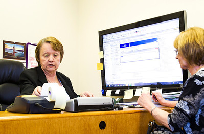 Kyle Grillot - kgrillot@shawmedia.com   Onsite Accounting and Tax Services owner Yvonne Cornett (left) looks over taxes with Leah Iverson of Cary Wednesday in Crystal Lake. Less than one percent of taxpayers actually face and IRS audit.