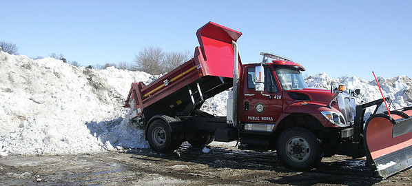 """H. Rick Bamman - hbamman@shawmedia.com  Crystal Lake maintenance worker Tom """"Bubba"""" Aellig (cq) dumps a load of snow in the compost yard after it was cleared from Brink Street in Crystal Lake Wednesday, Feb 18, 2014."""