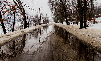 Kyle Grillot - kgrillot@shawmedia.com   Water collects along North River Road in Algonquin Thursday, February 20, 2014. The National Weather Service has issued a flood advisory for much of northeastern Illinois, including portions of southern McHenry County.
