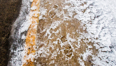 Kyle Grillot - kgrillot@shawmedia.com   A mixture of snow and rain left about an inch of moisture over the sidewalks in Fox River Grove Thursday, February 20, 2014. The National Weather Service has issued a flood advisory for much of northeastern Illinois, including portions of southern McHenry County.