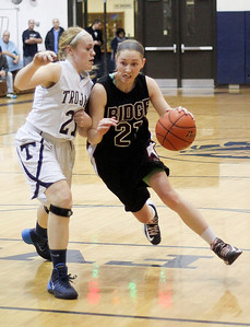 Sarah Nader- snader@shawmedia.com Cary-Grove's Sarah Kendeigh (left) guards Prairie Ridge's  Kelly Kiendworth as she dribbles towards the basket during the fourth quarter of the Class 4A Cary-Grove Regional final Friday, February 21, 2014. Prairie Ridge won, 46-42.