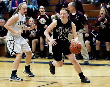 Sarah Nader- snader@shawmedia.com Cary-Grove's Katie Barker (left) guards Prairie Ridge's Aly Clark while she brings the ball towards the basket during the fourth quarter of the Class 4A Cary-Grove Regional final Friday, February 21, 2014. Prairie Ridge won, 46-42.