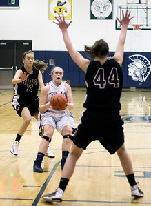 Sarah Nader- snader@shawmedia.com Cary-Grove's Cary-Grove's Sarah Kendeigh (center) gets ready to shoot over Prairie Ridge's Kirsten Voel-Pel during the first quarter of the Class 4A Cary-Grove Regional final  Friday, February 21, 2014. Prairie Ridge won, 46-42.
