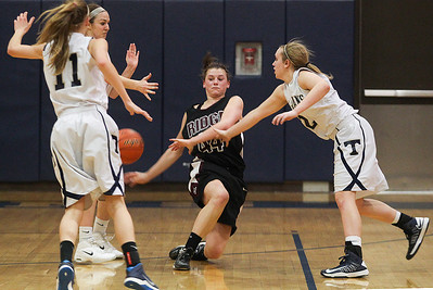 Sarah Nader- snader@shawmedia.com Prairie Ridge's Kirsten Voel-Pel (center) loses control of the ball during the fourth quarter of Friday's Class 4A Cary-Grove Regional final against Cary-Grove Friday, February 21, 2014. Prairie Ridge won, 46-42.
