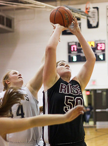 Sarah Nader- snader@shawmedia.com Cary-Grove's Brianne Prank (left) guards Prairie Ridge's Maddie Drain as she shoots during the second quarter of the Class 4A Cary-Grove Regional final Friday, February 21, 2014. Prairie Ridge won, 46-42.