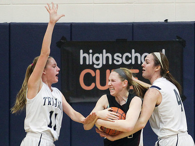 Sarah Nader- snader@shawmedia.com Cary-Grove's Candace Cunningham (left) guards Prairie Ridge's Kelly Kiendworth with Cary-Grove's Abby Glaysher during the fourth quarter of Friday's Class 4A Cary-Grove Regional final Friday, February 21, 2014. Prairie Ridge won, 46-42.