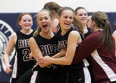 Sarah Nader- snader@shawmedia.com Prairie Ridge's Sarah Kilhoffer (left) and Sarah Le Beau celebrates after winning the Class 4A Cary-Grove Regional final against Cary-Grove Friday, February 21, 2014. Prairie Ridge won, 46-42.