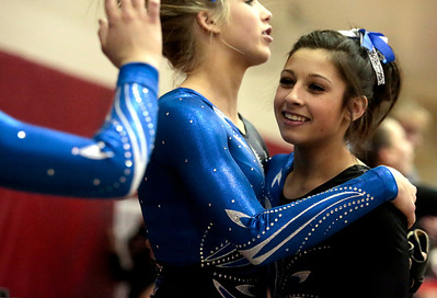 Kyle Grillot - kgrillot@shawmedia.com  Geneva freshman Claire Rose Ginsberg is greeted by her teammates after competing in the vault event of the IHSA Girls Gymnastics State Meet Friday in Palatine.