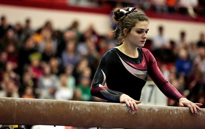 Kyle Grillot - kgrillot@shawmedia.com  Prairie Ridge junior Rachel Underwood goes to climb back onto the bar while competing in the balance beam event of the IHSA Girls Gymnastics State Meet Friday in Palatine.