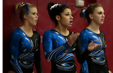 Kyle Grillot - kgrillot@shawmedia.com  Geneva freshman Claire Rose Ginsberg (center) cheers on her teammates during the vault event of the IHSA Girls Gymnastics State Meet Friday in Palatine. Ginsberg won the individual All-Around category.