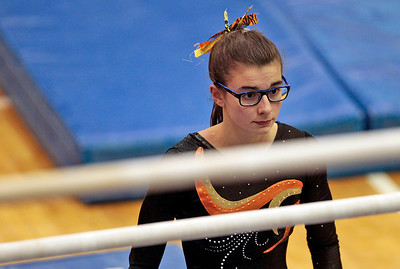Kyle Grillot - kgrillot@shawmedia.com   Dekalb senior Meredith Whisenhunt prepares to compete in the uneven bars event of the IHSA Girls Gymnastics State Meet Friday in Palatine.