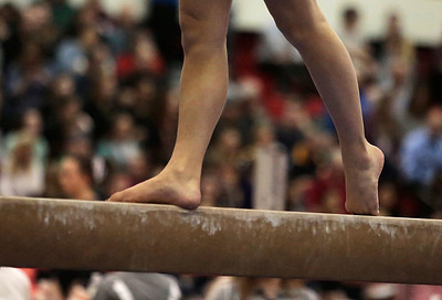 Kyle Grillot - kgrillot@shawmedia.com  Prairie Ridge sophomore Maddie Solka competes in the balance beam event of the IHSA Girls Gymnastics State Meet Friday in Palatine.