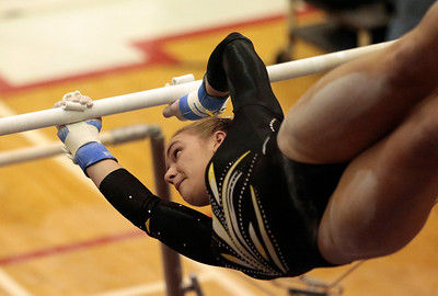 Kyle Grillot - kgrillot@shawmedia.com   Jacobs junior Alli Riedel competes in the uneven bars event of the IHSA Girls Gymnastics State Meet Friday in Palatine.