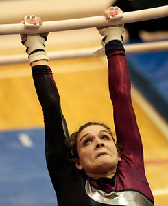 Kyle Grillot - kgrillot@shawmedia.com  Prairie Ridge junior Rachel Underwood competes in the uneven bars event of the IHSA Girls Gymnastics State Meet Friday in Palatine.