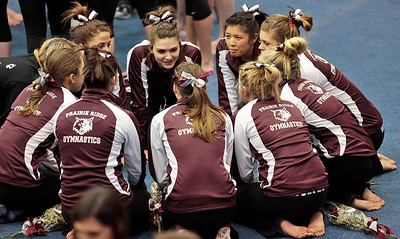Kyle Grillot - kgrillot@shawmedia.com   The Priarie Ridge team comes together before the start of the IHSA Girls Gymnastics State Meet Friday in Palatine.