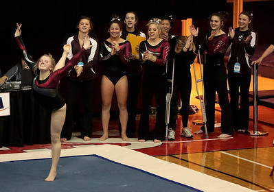 Kyle Grillot - kgrillot@shawmedia.com   The Priarie Ridge team cheers as juniro Jada Berkland completes her floor exercise at the IHSA Girls Gymnastics State Meet Friday in Palatine.
