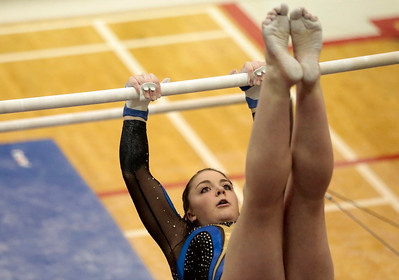Kyle Grillot - kgrillot@shawmedia.com   Lyons Township junior Kelsy Kurfirst competes in the uneven bars event of the IHSA Girls Gymnastics State Meet Friday in Palatine.