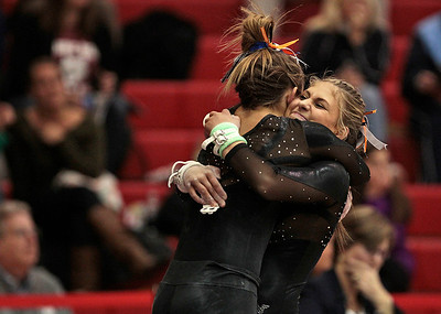 Kyle Grillot - kgrillot@shawmedia.com  St. Charles North sophomore Rachel Dugan is greeted by a teammate after competing in the uneven bars event of the IHSA Girls Gymnastics State Meet Friday in Palatine.