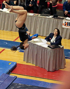 Kyle Grillot - kgrillot@shawmedia.com  Geneva junior Grace Ginsberg dismounts from the balance beam event of the IHSA Girls Gymnastics State Meet Friday in Palatine.