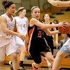 Katelyn Claussner of St. Charles East (11) drives toward the basket during their Batavia Regional game against Willowbrook Tuesday night.