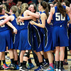 The Geneva girls basketball team celebrates their Wheaton North Regional win over Wheaton North Thursday night.