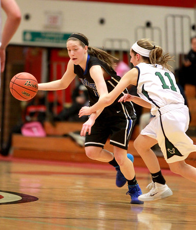 St. Charles North's Kyla Helsel (15) dribbles the ball during their Glenbard East Regional game against Bartlett Wednesday night.