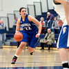 Geneva's Sidney Santos dribbles down court during their Wheaton North Regional game against Wheaton North Thursday night.