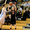 Kelly Rinker of St. Charles East attempts three points during their Batavia Regional game against Willowbrook Tuesday night.
