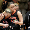 St. Charles East's Katelyn Claussner (left) and Maryn Cheney (right) console each other following their 58-56 Batavia Regional loss to Willowbrook Tuesday night.