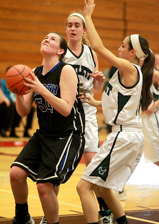 St. Charles North's Liz McNally (54) attempts a shot under the basket during their Glenbard East Regional game against Bartlett Wednesday night.