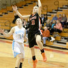 St. Charles East's Katelyn Claussner (11) goes up for a shot during their Batavia Regional game against Willowbrook Tuesday night.