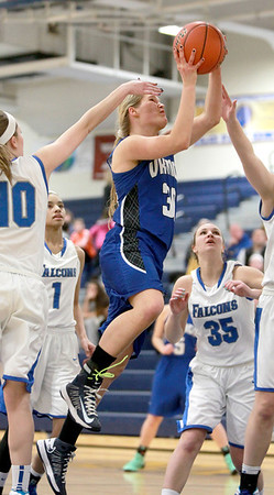 Geneva's Janie McCloughan (30) goes up for a shot during their Wheaton North Regional game against Wheaton North Thursday night.