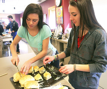 H. Rick Bamman - hbamman@shawmedia.com  Prairie Ridge High School commercial foods students Jackie Siffrar (left) and Claire Pipia (cq) prepare thier sandwhich for taste testing.  The commercial foods and marketing classes teamed up to create Duke's special menu for April. The marketing class analyzed the restaurant, and the commercial foods class worked with the data to create menu selections in six categories: appetizers, soup/salad, sandwich, burger, entrée, and a vegetable side.