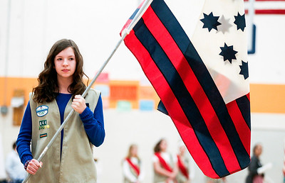 Sarah Nader- snader@shawmedia.com Julianne Amato, 13, of Crystal Lake carries a flag while attending an event for Girl Scouts hosted by the Kshwaukee Trail chapter of Daughters of the American Revolution at Hannah Beardsley Middle School in Crystal Lake Saturday, February 22, 2014.  Girl Scouts learned about historical flags, flag etiquette, conducting a flag ceremony and the history of the American flag during the event.