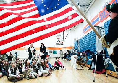 Sarah Nader- snader@shawmedia.com The Kshwaukee Trail chapter of Daughters of the American Revolution teaches area Girl Scouts about historical flags, flag etiquette, conducting a flag ceremony and the history of the American flag at Hannah Beardsley Middle School in Crystal Lake Saturday, February 22, 2014.