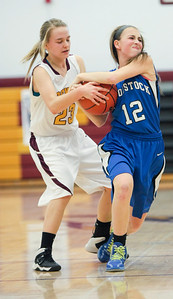 Michelle LaVigne/ For Shaw Media Woodstock's Grace Beattie (12) fights for possession from Richmond-Burton's Lauren Otto (23) during the girls basketball final in Richmond on Saturday, February 22, 2104.