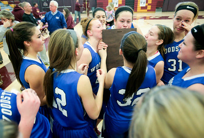 Michelle LaVigne/ For Shaw Media The Woodstock girls basketball team takes turns kissing their regional champion plaque after winning against Woodstock in the girls basketball final in Richmond on Saturday, February 22, 2104.