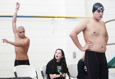 Sarah Nader- snader@shawmedia.com Cary-Grove's Chase Castro (left) gets ready to compete in the 200 yard freestyle during Saturday's swimming sectional at Stevenson High School February 22, 2014.