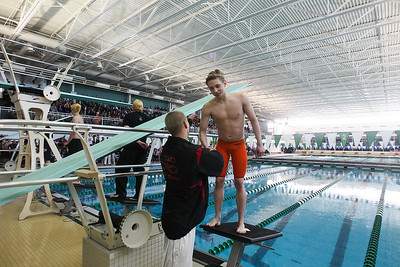 Sarah Nader- snader@shawmedia.com Jacobs' Alex Reinbrecht  (left) and McHenry's Trey Schopen congratulate each other after competing in the 200 yard freestyle during Saturday's swimming sectional at Stevenson High School February 22, 2014.