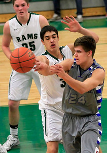 Candace H. Johnson Woodstock's Zach Cullum looks to pass against Grayslake Central's David Llorens in the second quarter at Grayslake Central High School. Woodstock won 61-55. Grayslake Central defender, Alex Lennartz, stood close by.
