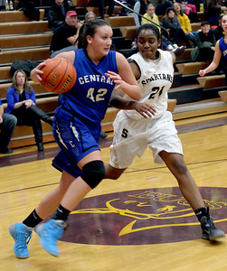 Sarah Nader - snader@shawmedia.com Burlington Central's Alison Colby (left) is guarded by Sycamore's Taiya Hopkins during the fourth quarter of Monday's Class 3A Belvidere Sectional on February 24, 2014. Burlington Central won defeated Sycamore, 42-28.